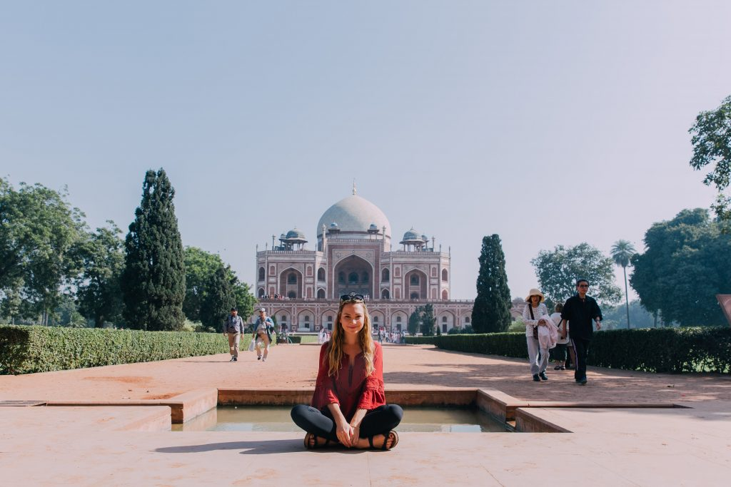 'Girl in front of Humayun's Tomb'- The best way to travel India: solo or group tour